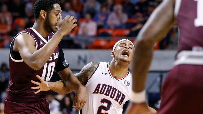 Auburn guard Bryce Brown reacts to being fouled by Texas A&M center Tonny Trocha-Morelos during the first half of an NCAA college basketball game on Wednesday, Feb. 7, 2018, in Auburn, Ala. Brown would exit the game after just 15 minutes with a shoulder injury.