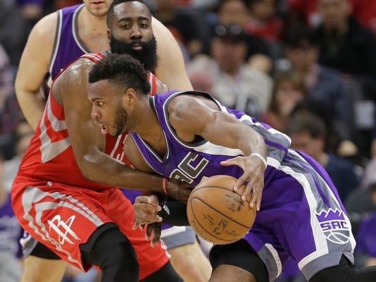 Sacramento Kings guard Buddy Hield, right, drives against Houston Rockets guard James Harden during the first half of an NBA basketball game, Sunday, April 9, 2017, in Sacramento, Calif. (AP Photo/Rich Pedroncelli)