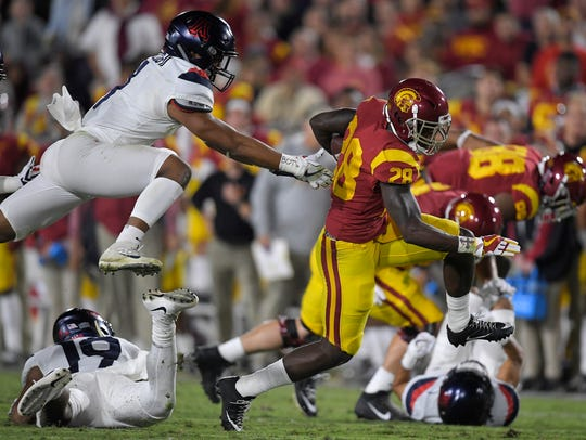 Southern California running back Aca'Cedric Ware, right,