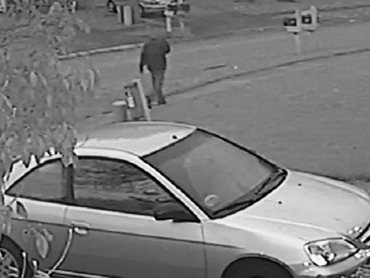 Indianapolis police released two surveillance photos