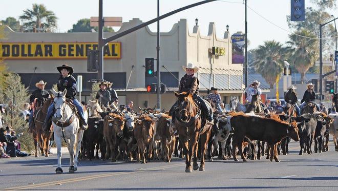 A 50-head cattle drive will precede the parade Saturday morning.