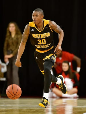 Lavone Holland II brings the ball up for NKU.