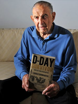 """Retired physician Harold Baumgarten, author of """"D-Day Survivor: An Autobiography,"""" at his home in Jacksonville Beach, Fla. Baumgarten's belief that """"it was more than luck"""" that he survived the Normandy landings — when he was wounded five times in two days — has fueled his efforts to educate people about the sacrifices made by comrades who died in the invasion."""
