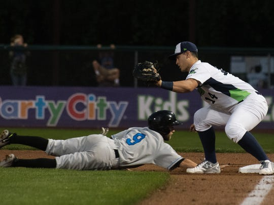Hudson Valley's Deion Tansel (9) dives back to the bag as Vermont's Oscar Tover (34) tries to tag him out during game 2 of the NY-Penn League championship series between the Hudson Valley Renegades and the Vermont Lake Monsters at Centennial Field on Thursday night September 14, 2017 in Burlington.
