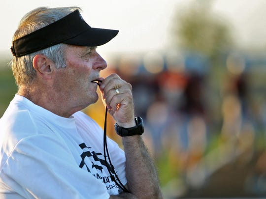 Ankeny Centennial's Jerry Pezzetti is one of three coaches to pass the 400-win milestone.