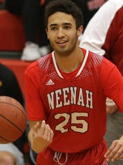 Zavier Sims of Neenah loosens up before a recent game