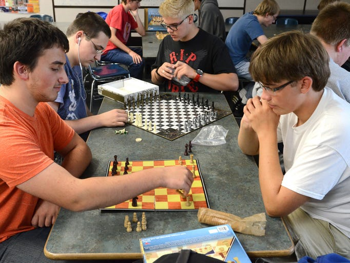 Andrew Prescott, right, and Nick Bednark play a game