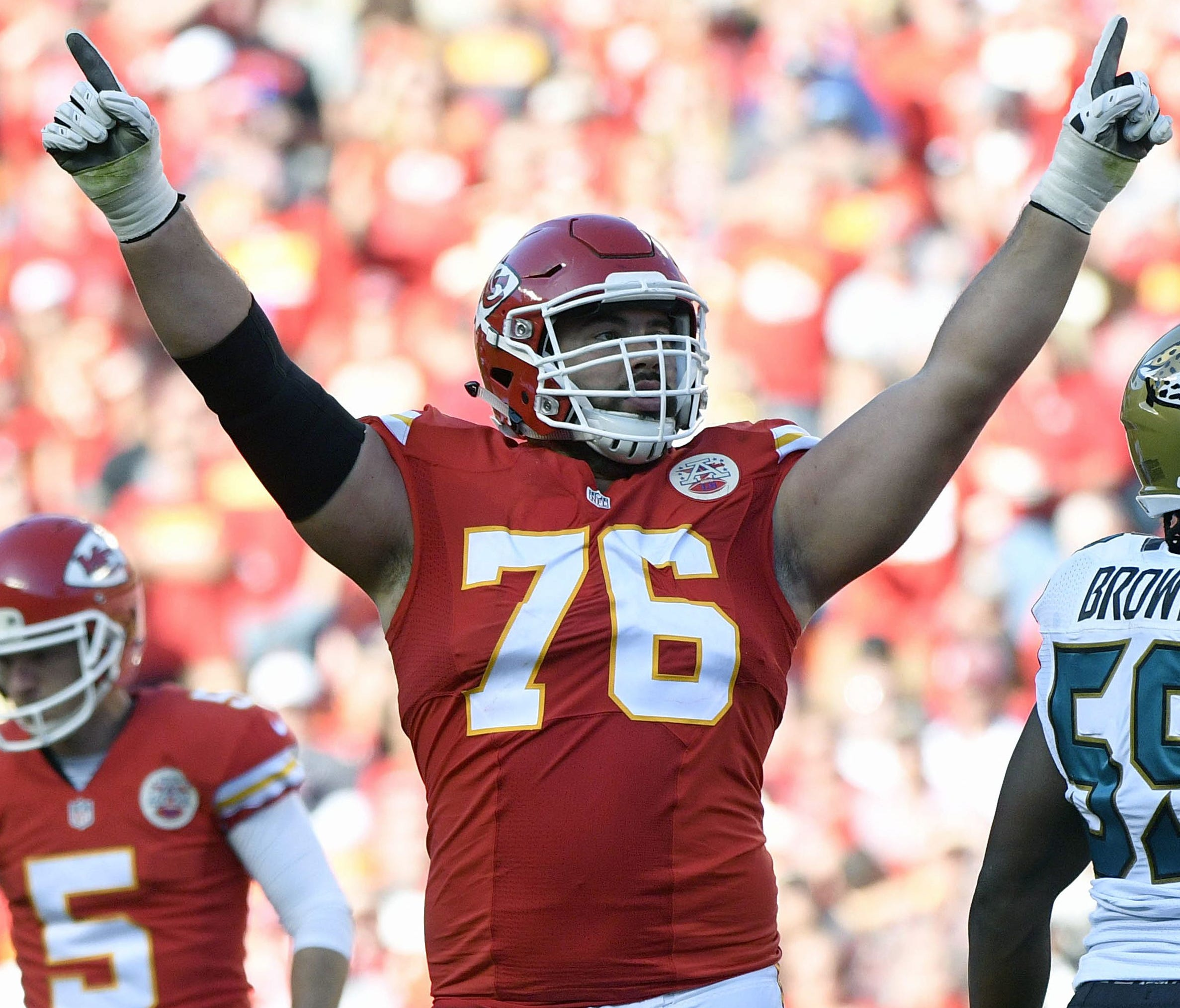 FILE - In this Nov. 6, 2016, file photo, Kansas City Chiefs offensive lineman Laurent Duvernay-Tardif (76) celebrates after a field goal by kicker Cairo Santos (5), during the second half of an NFL football game against the Jacksonville Jaguars in Ka