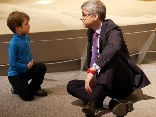 "Billy Rozelle, 5, of Novi, , left, chats with his favorite television program host Mo Rocca, as Rocca takes a break from shooting the program, ""The Henry Ford's Innovation Nation,"" a weekly half-hour news magazine at the Dearborn museum Monday, Dec. 8, 2014."