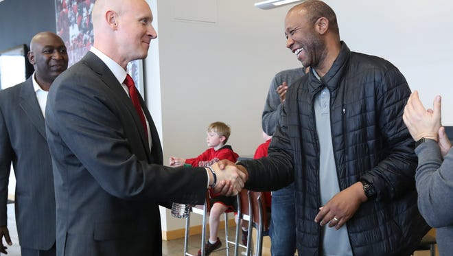 New Louisville basketball head coach Chris Mack, left, greeted former standout Milt Wagner just before he we was announced as coach at the Yum Center.    Mar. 28, 2018
