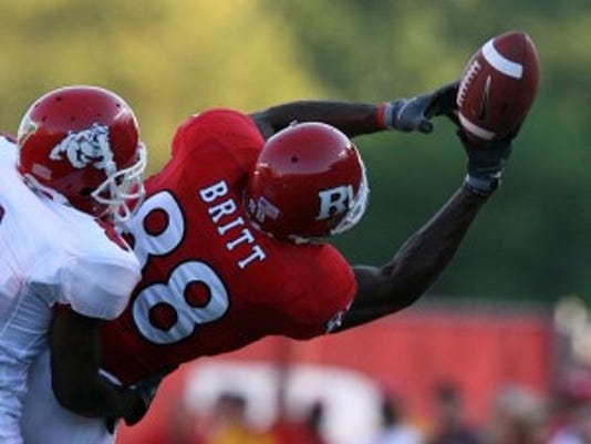 Wide receiver Kenny Britt gets his hands on a pass from quarterback Mike Teel. Where did they fall in the Rutgers football mock draft?
