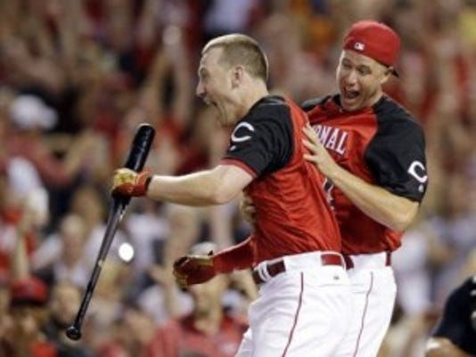 Rutgers product Todd Frazier, left, of the Cincinnati Reds, reacts after winning the MLB Home Run Derby.(Photo: AP)