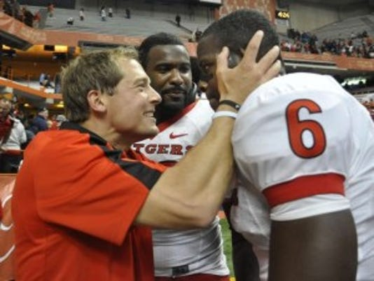 Then-Rutgers wide receivers coach, P.J. Fleck, left, congratulates wide receiver Mohamed Sanu after a win against Syracuse in 2011.(Photo: AP)