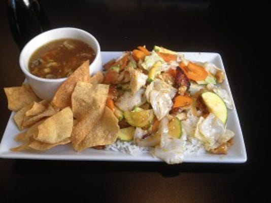 The Teriyaki Chicken Combo includes plenty of sliced carrots, squash and cabbage at CoLi Wok and Grille. The soup comes with tasty fried wonton strips.