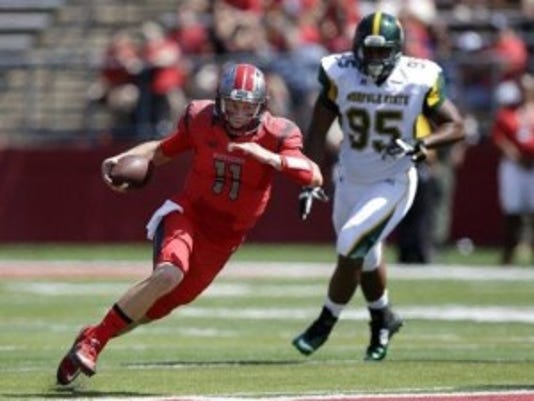 Rutgers quarterback Hayden Rettig (11) scrambles with the ball as Norfolk State defensive linebacker Chris Lee (95) chases during the first half of an NCAA college football game Saturday, Sept. 5, 2015, in Piscataway, N.J. (AP Photo/Mel Evans)(Photo: AP)