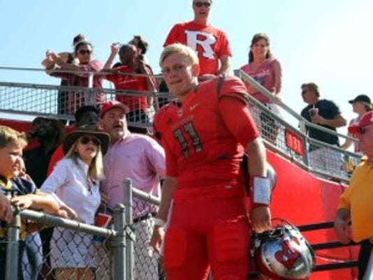 Rutgers quarterback Hayden Rettig returns from the stands following a postgame celebration of the win against Norfolk State.(Photo: Kathy Johnson/Staff Photographer)