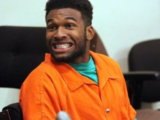 Dre Boggs mugs in court as he and other Rutgers students are arraigned before Middlesex County Superior Judge.(Photo: Kathy Johnson, Kathy Johnson/Staff Photographer)