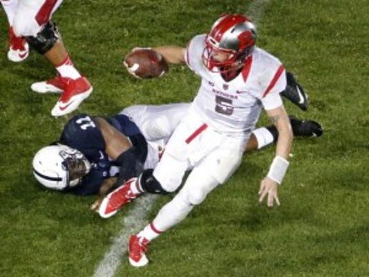 Rutgers quarterback Chris Laviano (5) slips the grasp of Penn State linebacker Brandon Bell (11) during the second half of an NCAA college football game in State College, Pa., Saturday, Sept. 19, 2015. Penn State won 28-3. (AP Photo/Gene J. Puskar)(Photo: AP)