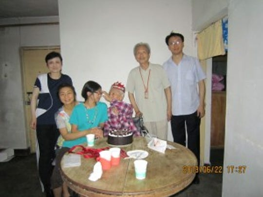 Recent photo of Zhong with her family in China