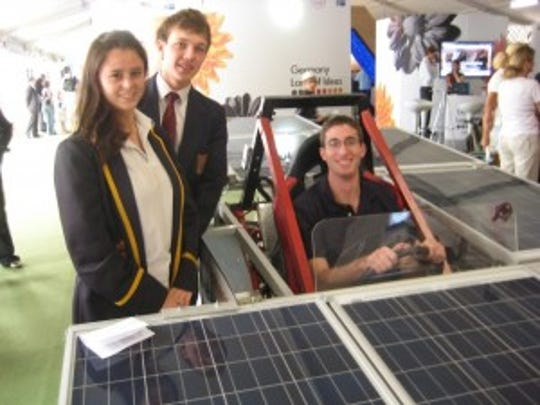 At 2011 COP 17 in Durban, South Africa, ACS Student Ambassador Patrick Lestrange (York College) sits in solar car constructed by High School Students at Deutsche Schule Johannesburg, South Africa.