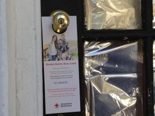 Fliers with Red Cross contact information were put on doors where residents weren't home during a Red Cross home fire prevention campaign. (Mark Walters - Daily Record/Sunday News)