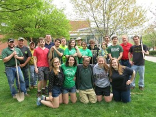 """The Earth Day """"grunt' crew planted nine trees on campus."""