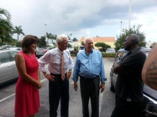 Gubernatorial candidate Charlie Crist (second from left) was in West Palm Beach on July 18 with his recently appointed running mate, Annette Taddeo (left). Copyright 2014 Scripps Media, Inc. All rights reserved. This material may not be published, broadcast, rewritten, or redistributed.
