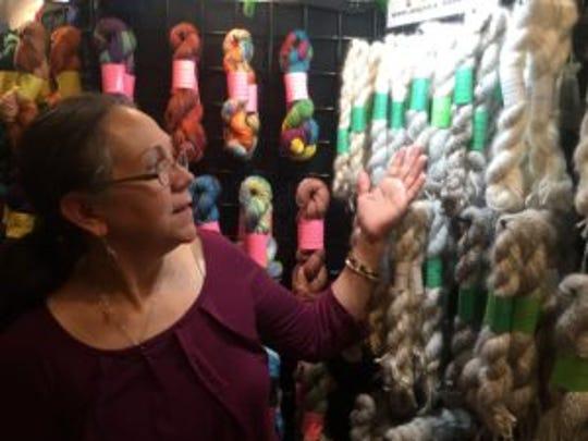Marlene, from Haddonfield, Nj, shows off her handspun Angora rabbit yarn at the fiber festival.