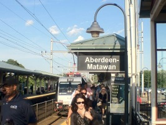 Problems with overhead wires belonging to Amtrak , like the ones powering this NJ Transit train in Matawan, halted all trains on Northeast Corridor Tuesday morning