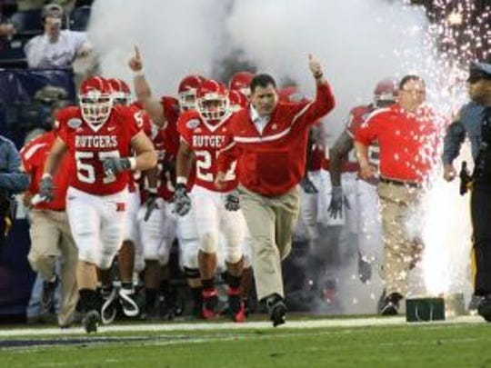 Rutgers, coached at the time by Greg Schiano (right), runs out of the tunnel prior to the 2006 Texas Bowl against Kansas State.(Photo: File photo)