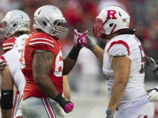 Rutgers center Betim Bujari, right, protected quarterback Gary Nova from the likes of Ohio State defensive tackle Michael Bennett.(Photo: Greg Bartram/USA TODAY Sports)