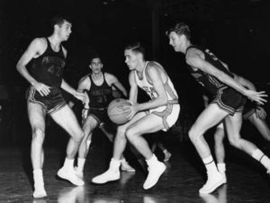 Rutgers' Bob Lloyd (center, in white) drives against Princ.eton and Bill Bradley (No. 42) (Photo: Rutgers Athletics)