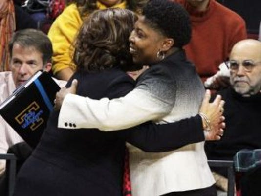 Rutgers coach C. Vivian Stringer, left, hugs Tennessee assistant coach Jolette Law earlier this month. Stringer coached Law at Iowa. (Mark Sullivan/Staff photographer)