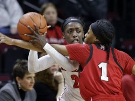 Rutgers guard Kahleah Copper (2) looks to make a pass as Nebraska guard Tear'a Laudermill (1) defends during Thursday's matchup at the RAC. (Photo: AP)