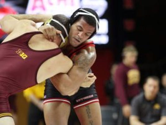 Andrew Campolattano (right) will not return to the Rutgers lineup at 197 pounds for the Big Ten Championships.(Photo: Jason Towlen/Staff photographer)