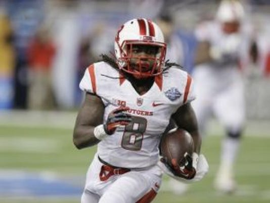 Rutgers running back Josh Hicks runs during the second half of the Quick Lane Bowl NCAA college football game against North Carolina, Friday, Dec. 26, 2014, in Detroit. Rutgers defeated North Carolina 40-21. (AP Photo/Carlos Osorio)