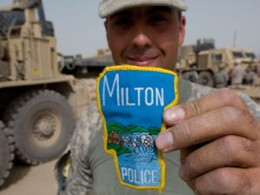 Sgt. Warren Burnor of Johnson shows off his Milton Police patch after Echo Company arrived at a new Afghan Combat Post in Rahman Kheyl, a remote part of Afghanistan in southern Paktia province, on Tuesday, September 14, 2010.  RYAN MERCER / Free Press