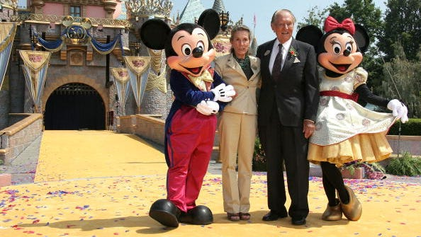 Diane Disney Miller, daughter of Walt Disney with actor Art Linkletter, Mickey and Minnie Mouse at Disneyland's 50th Anniversary rededication ceremony on July 17, 2005, in Anaheim, Calif.