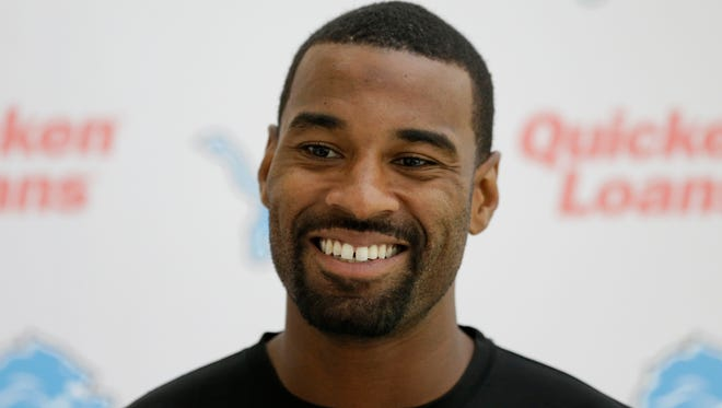 Detroit Lions wide receiver Calvin Johnson smiles during a news conference in Chandler's Cross, England, on Wednesday, Oct. 28, 2015.