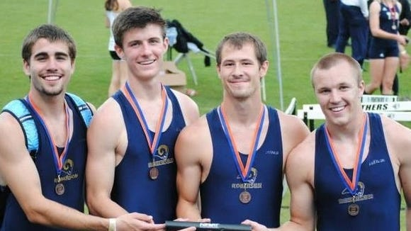 Roberson senior Drew Barker, far left, has committed to run college track for Charlotte.