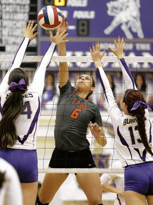 MARK LAMBIE-EL PASO TIMES  El Paso High's Diana Lopez hits while being defended by Burges blockers Victoria Navarro, left, and Marissa Castillo during their match Tuesday at Burges High School. El Paso High won in straight sets.