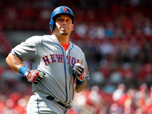 New York Mets' Asdrubal Cabrera looks into the crowd after flying out during the ninth inning of a baseball game against the St. Louis Cardinals, Sunday, July 9, 2017, in St. Louis. (AP Photo/Jeff Roberson)