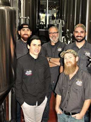 The Hell 'n Blazes Brewing Co. crew includes, front from left, operations manager Jonathan DiFrisco and brew master Todd Furbeck; back from left, senior brewer Jimmy DiFrisco, owner Don DiFrisco and general manager Andy Pinkerton.