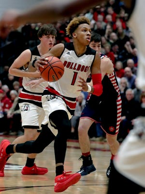 New Albany's Romeo Langford drives to the basket against Bedford North Lawrence.