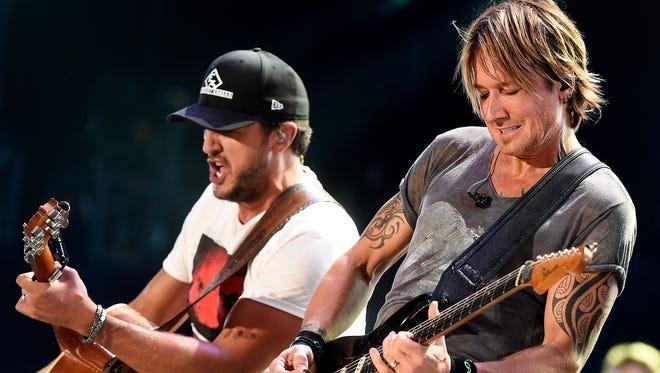 Luke Bryan and Keith Urban perform on the last night of the 2016 CMA Music Festival at Nissan Stadium in Nashville, Tenn.