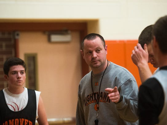 Hanover head coach Nathan Myers discusses a drill with