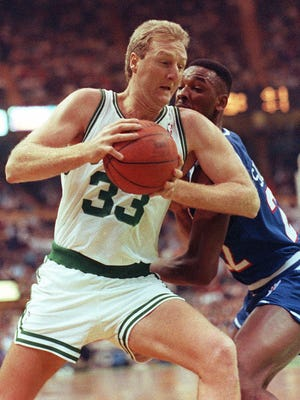 Boston Celtics' forward Larry Bird is shown driving on the basket in this Nov. 23, 1990, photo.