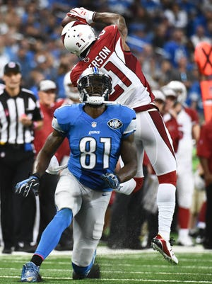 Oct. 11, 2015; Detroit; Arizona Cardinals cornerback Patrick Peterson intercepts a pass intended for Detroit Lions wide receiver Calvin Johnson (81) during the third quarter at Ford Field. The Cardinals won 42-17.