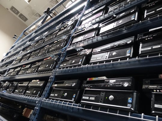 Walls of VCRs line the racks at iMemories headquarters in Scottsdale.