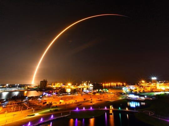 The early Sunday morning launch of the SpaceX Falcon 9 rocket carrying a Telstar 19v communications satellite launched from Launch Complex 40 at Cape Canaveral Air Force Station at 1:50 a.m. An approximate three minute time exposure of the launch illuminating the sky over Port Canaveral viewed from Exploration Tower.